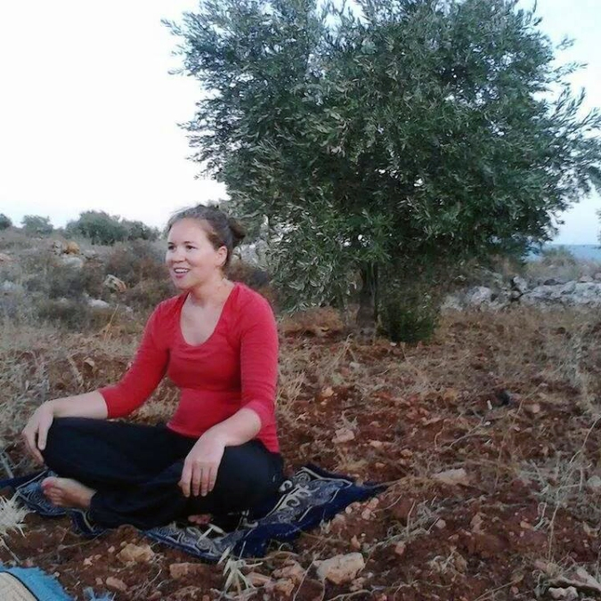 Proof you can practice yoga anywhere! Jackie chatting with her students from the olive orchard before class.